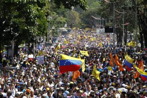 People Protesting with Venezuelan flag