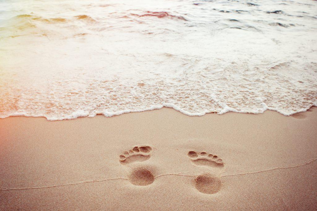 footprints in sand water