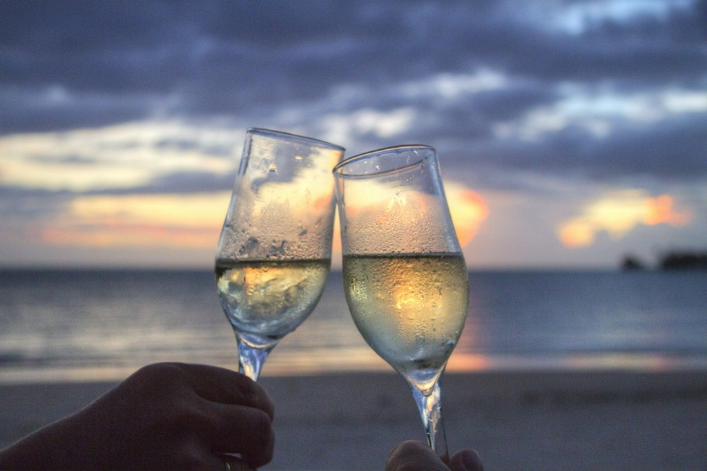 champagne glasses sunset beach