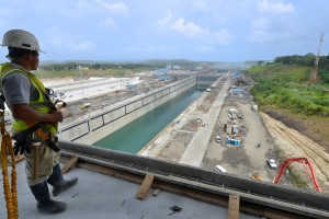 Photo of worker looking at widened canal